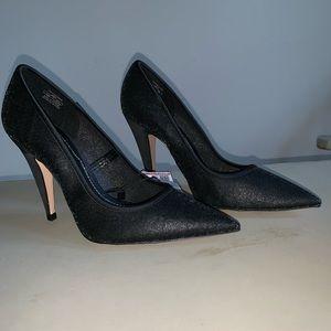 Zara woman black stilettos.